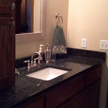 Titus Contracting   Bathroom sink and counter-top remodeled