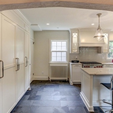 Arch-framed View of a Renovated Kitchen